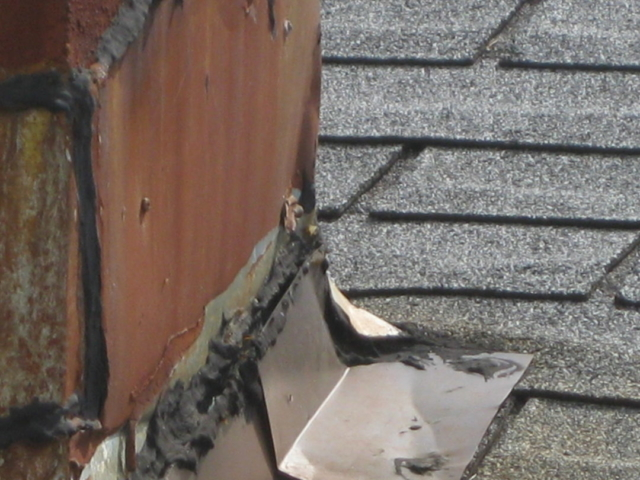 Chimney Flashing is Leaking found by Barrie's WETT Certified Inspections