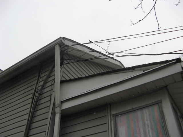 Bent Electrical Service Mast found by Barrie Home Inspections