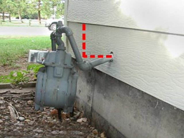 Bent Natural Gas Meter on Exterior of House