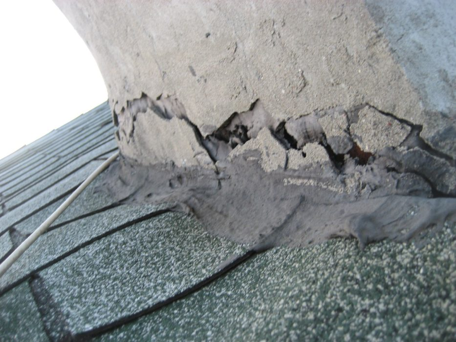 Tar Cracked at Chimney Flashing found by Barrie Home Inspections