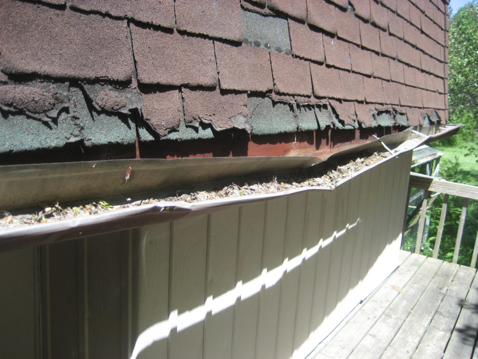 Mansard Roof has Damaged Shingles & Gutter found by Barrie Home Inspections