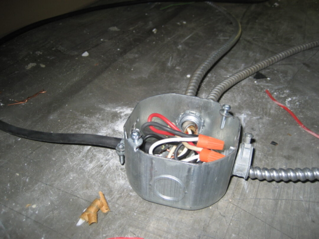 Junction Boxes are required to have Cover Plate and be Secured in place.