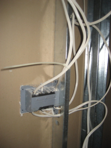 Electrical cables are required to be isolated from metal framing using approved products